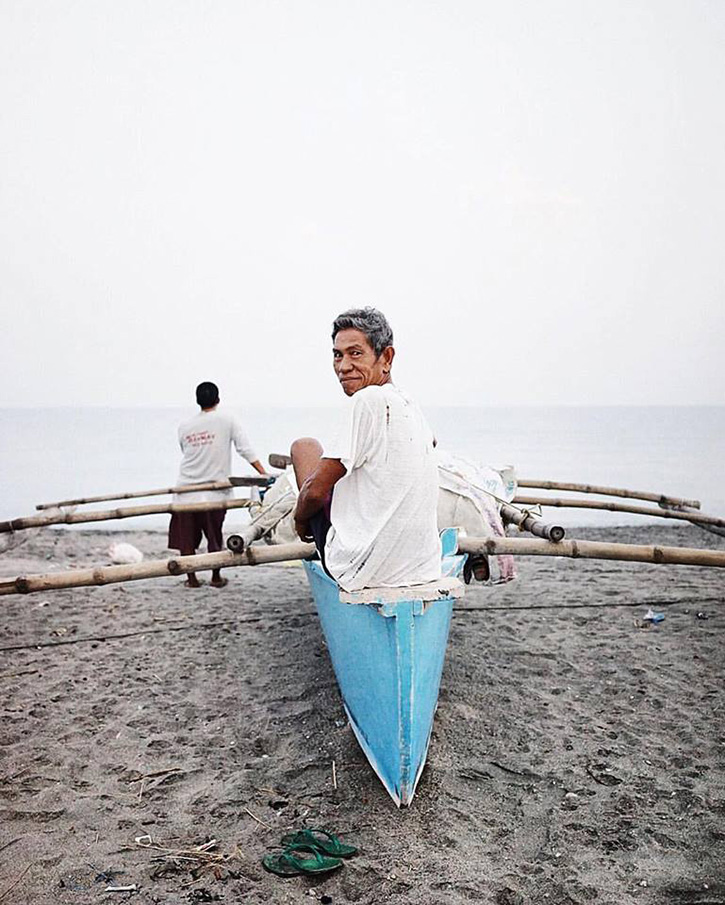 Here we are in Dad F's hometown. In the wee hours of the morning, local fishermen arrive at the beach to pull in their catch. This man is the owner of the banca.