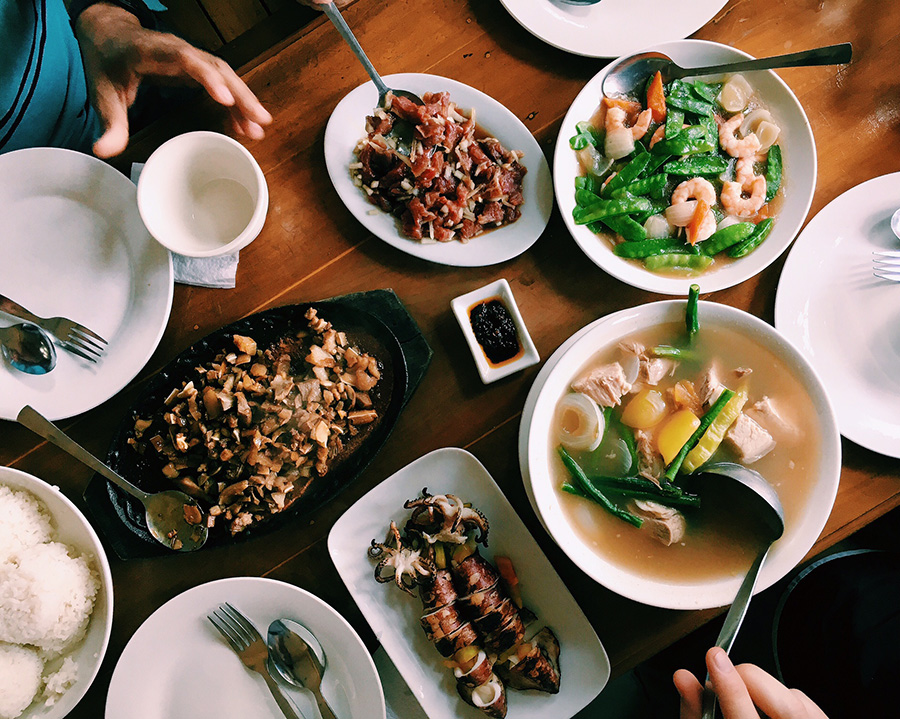 Lunch at Bon's in Iba, Zambales's capital city. Grilled squid, pork sinigang, snow peas and shrimp, raw beef kilawín (with bile), and sizzling pork sisig. This is the reason for siestas.