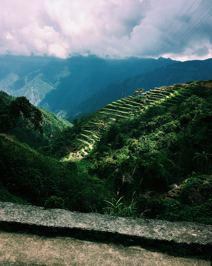 While most passengers sleep the entire ride to Sagada, silently swaying with every turn, my eyes stay wide open for moments like this... When the clouds break, we slow for the sharp turn, and the rice terraces come into view.