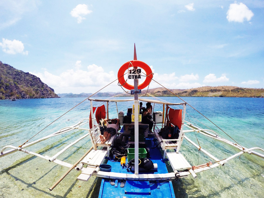 Our dive banca parked on Sangat Island for the East Tangat Wreck.