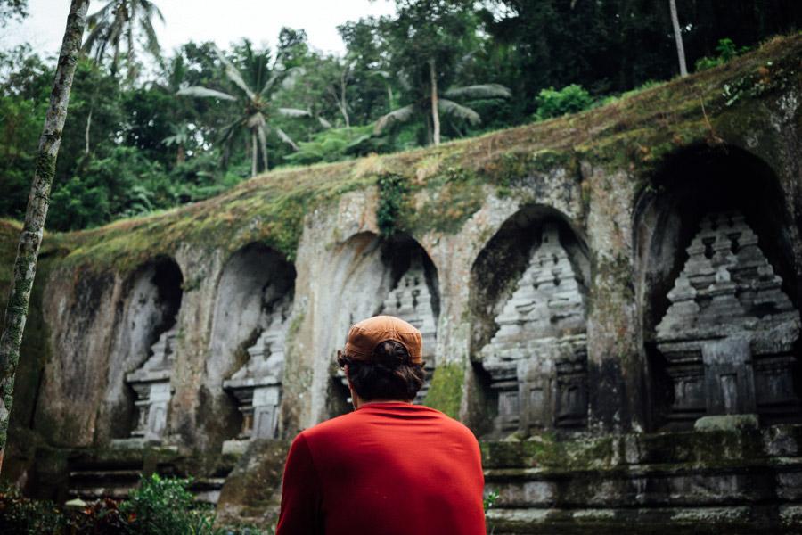 Admiring the stone reliefs at Pura Gunang Kawai.