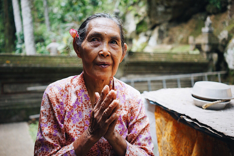 The lovely Balinese woman at Goa Gajah's Buddha temple who did an offering with us. After the prayer, she put holy water and a few grains of rice (bija, a symbol of the fertility of the mind) on our foreheads, and then a plumeria on our ears.