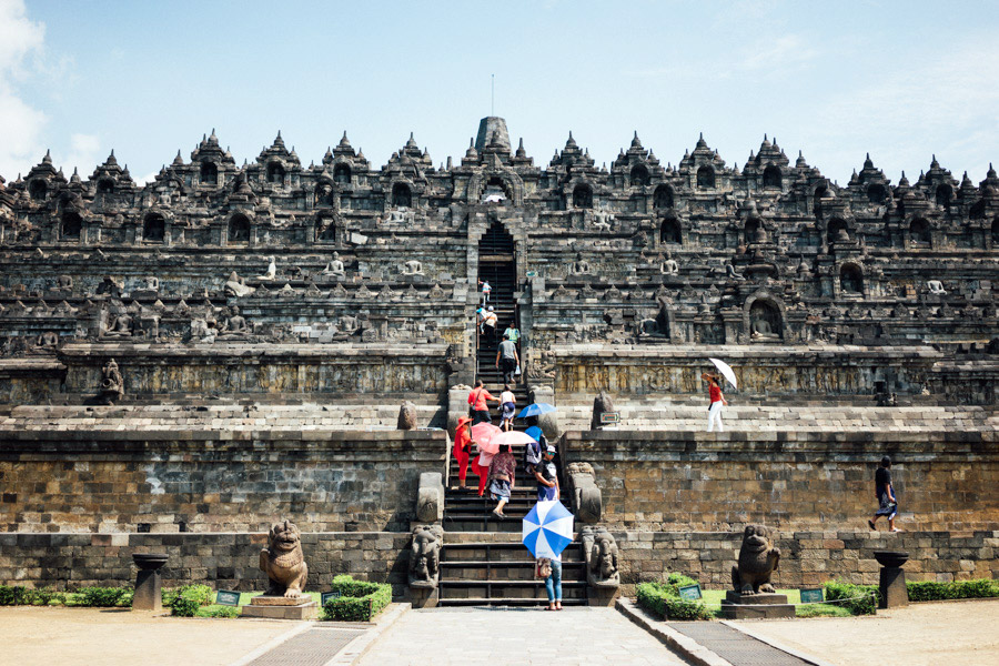 Just a small example of the candy-colored umbrellas you'll see at the candis of Yogyakarta. Here we are at the steps of the epic Borobudor, a complex with  2,673 relief panels and 504 Buddha statues. It's difficult to tell from this angle, and to even capture it in one photo, but this monument is the largest Buddhist temple in the world... and it was unearthed only 200 years ago. Amazing!