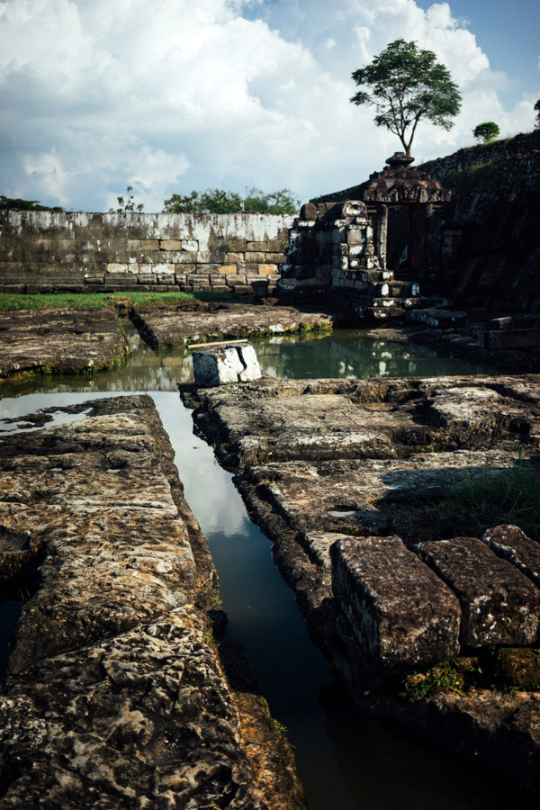 """Reflections on the pools of water that remain at the baths in Ratu Boko. It's believed by the Hindu people that one of these pools of water (""""Amerta Mantana"""") is sacred and brings luck to those who use it."""