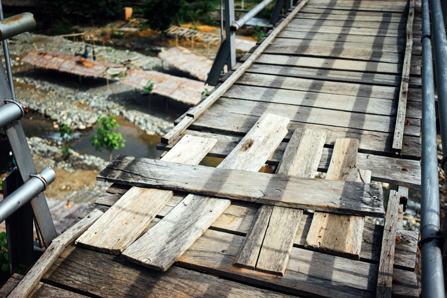 Missing planks on the highest part of the bridge.