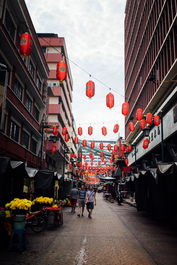 A much quieter street in Chinatown, with classic red lanterns and vendors selling Chrysanthemum garlands for the Indian wedding nearby.