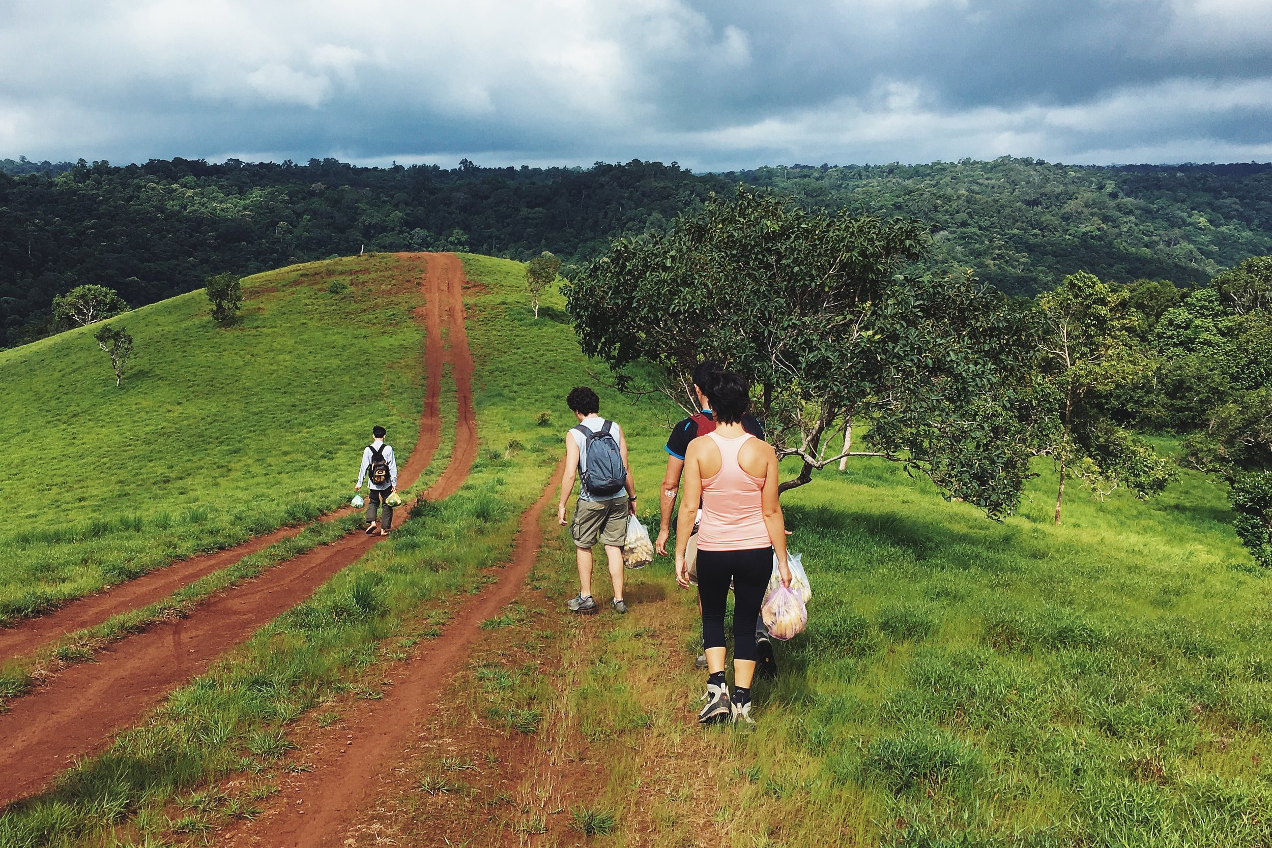Taking a short trek to the Mondulkiri Project jungle lodge.