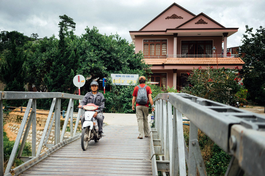 Passing the charming canals and homes of Da Lat.