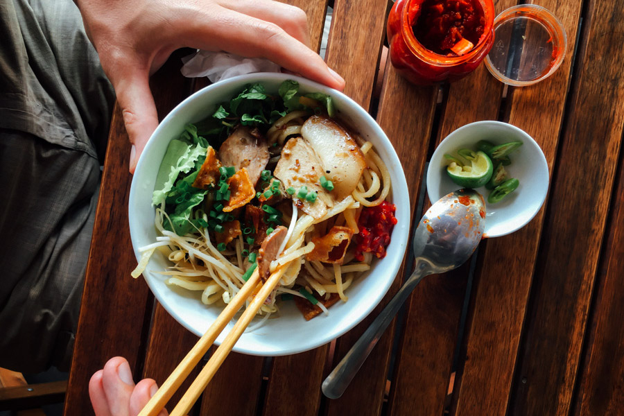 A delicious bowl of Cao Lau, a Hoi An specialty: noodles (similar to Japanese soba and believed to be made using ash and water from an ancient well), roasted pork, and greens. We're actually currently in Hanoi and are amazed by the variety of noodle and banh dishes we've eaten across the country, from Saigon to Hoi An to Hue to Hanoi.