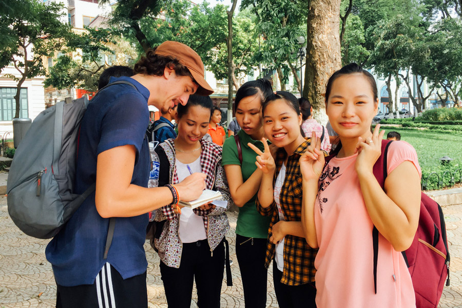 A group of students eager to practice their English with us!