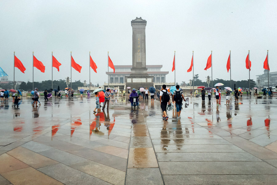 Tiananmen Square still full of people on a rainy summer day.