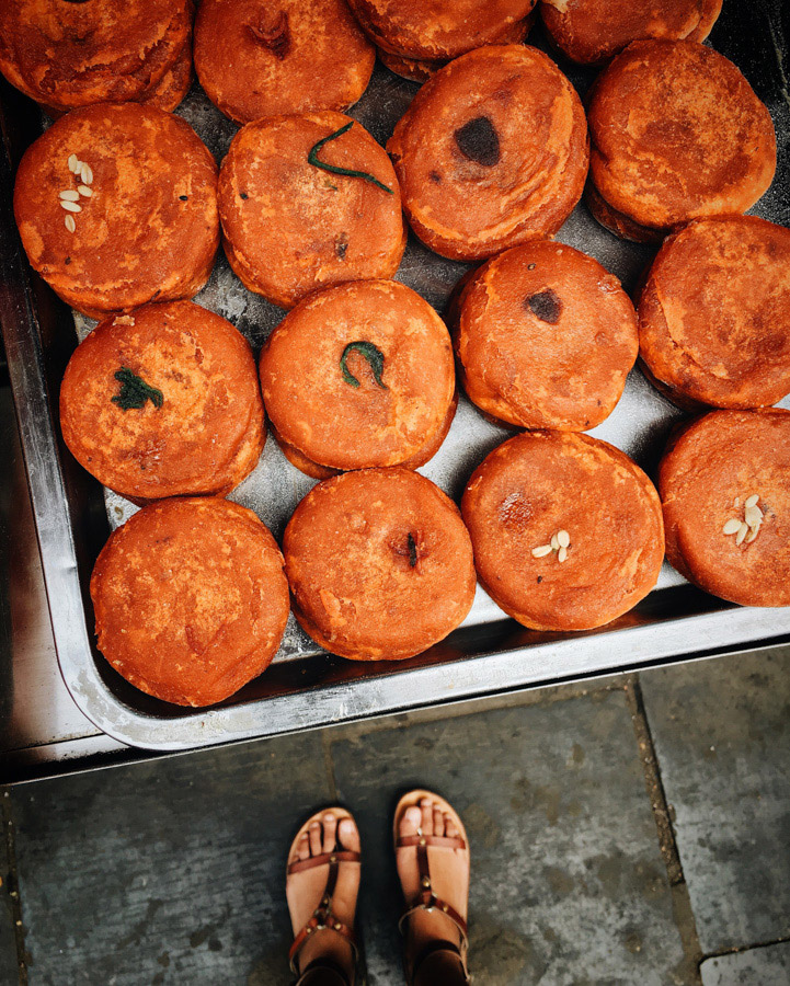 Persimmon donuts made from persimmon dough and stuffed with a variety of fillings from walnuts to black sesame. Have never had anything like it before!