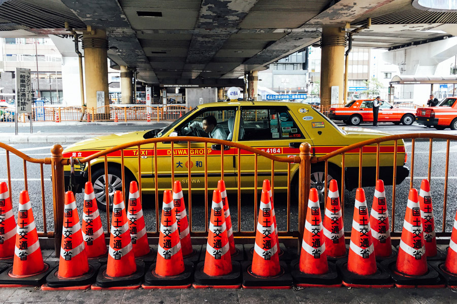 Covered colored cones and cars. Tokyo is full of rhythm.