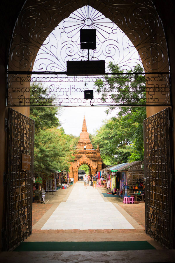 The Burmese script is so beautiful to me, full of circles and loops, blending harmoniously with the ironwork of the gate. Must be so fun to write.