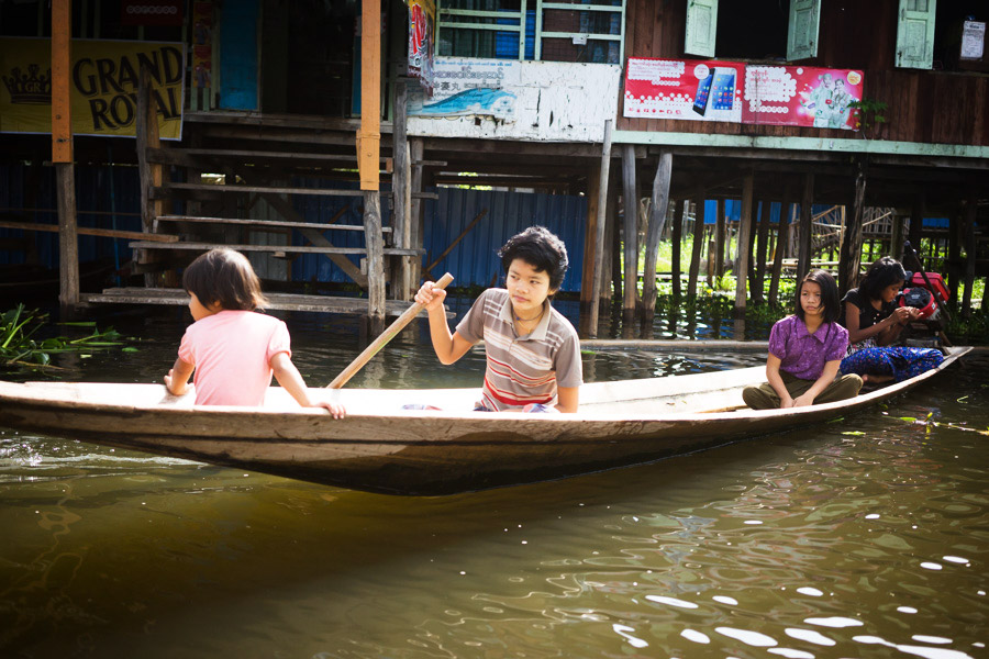 "Young Inthar (""people who live on the lake"") children going for a paddle. It's possible some of them have never seen or been in a car before."