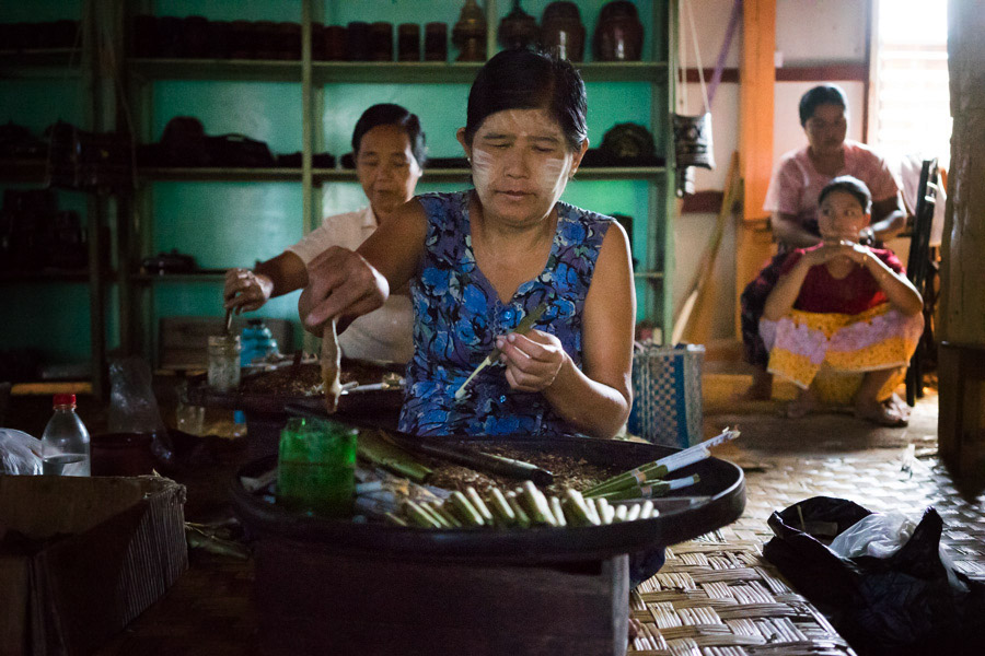Women at Inle Lake hand-rolling sweet cheroot cigars filled with tobacco, sugar, and spices, like star anise.