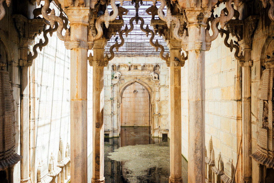 Raniji ki Baori and its intricately carved archways. Known as the Queen's stepwell, it was once a social gathering place for all the town. Today parts of it are undergoing restoration so that one day it may return to the same glory it was in back then.