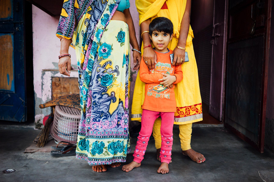 It was such a treat to be traveling to the outskirts of Delhi and photographing for Worldreader our last two days India. This little one finally warmed up at the end.