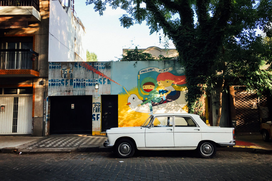 Street art and old cars in Palermo. This place feels familiar... like the old Mission District in San Francisco.