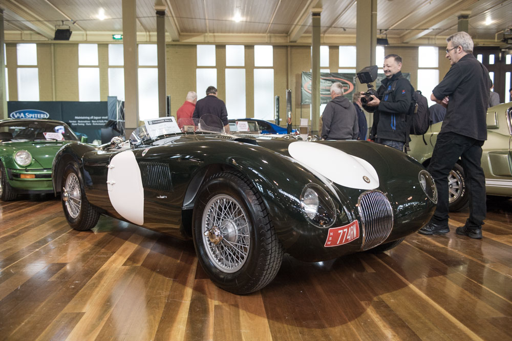 A 1964 Jaguar C-Type replica waiting in the auction area.
