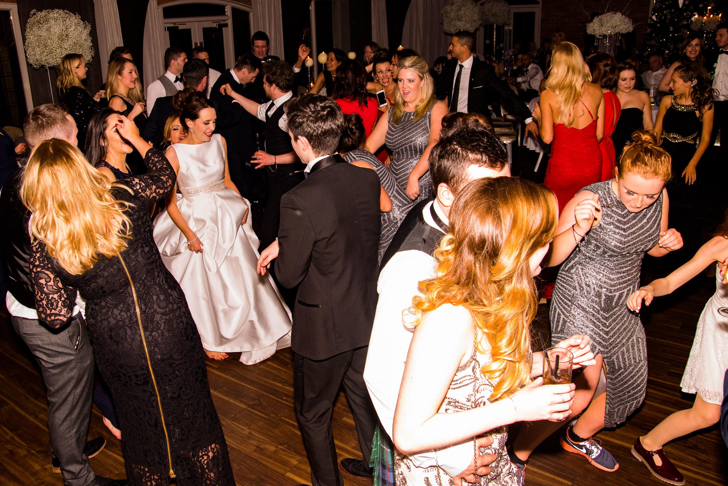 SPARKLY BRIDESMAID DRESSES ON THE COLSHAW HALL DANCEFLOOR. WEDDING DJ ADAM CARR PLAYING THE SONGS.