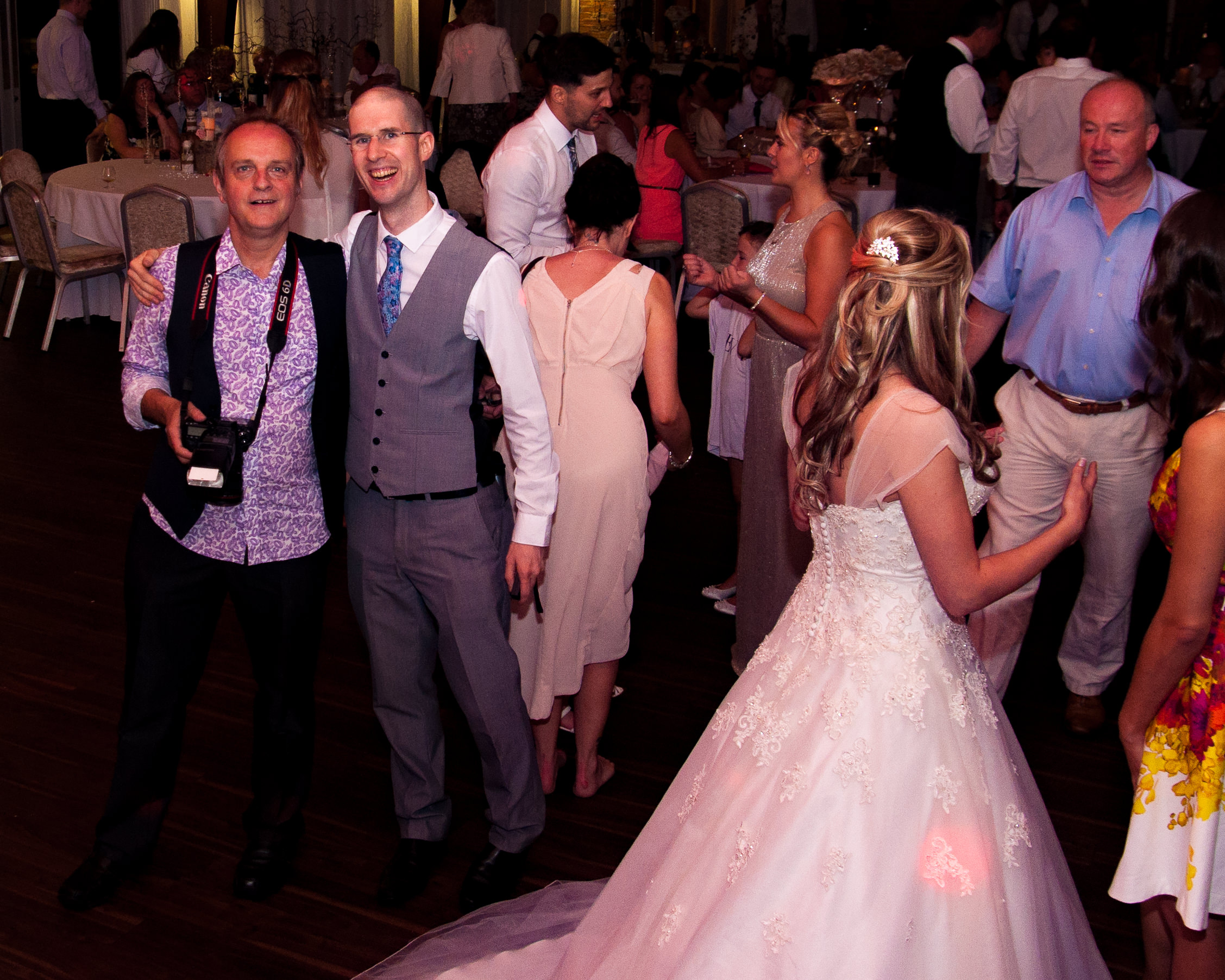 On the dancefloor. Wedding DJ Adam Carr with Andrew Collier at Colshaw Hall with bride in the fore ground.