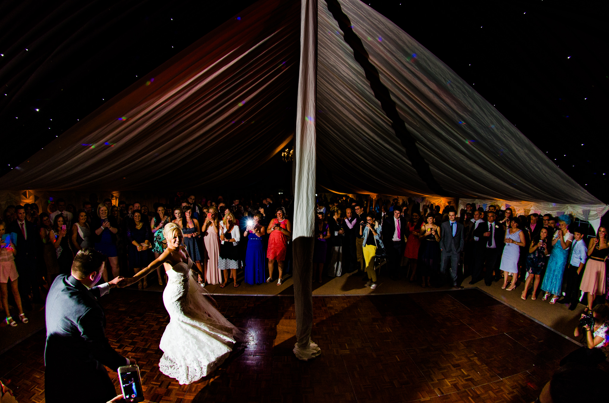 Epic Wide of First Dance to Thinking Out Loud before it was famous. Smiling crowd gathered around the dancefloor.