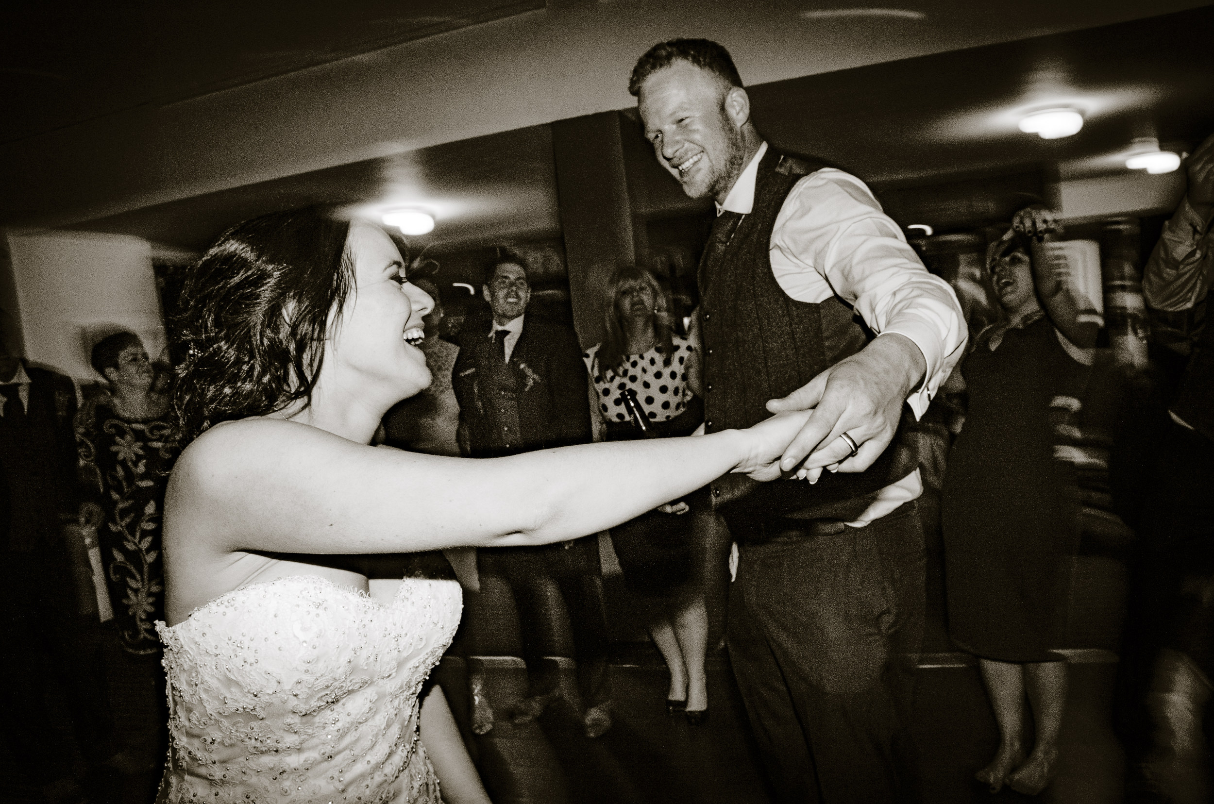 Bride and Groom dancing in the middle of the dancefloor. Mark twirling Kim.