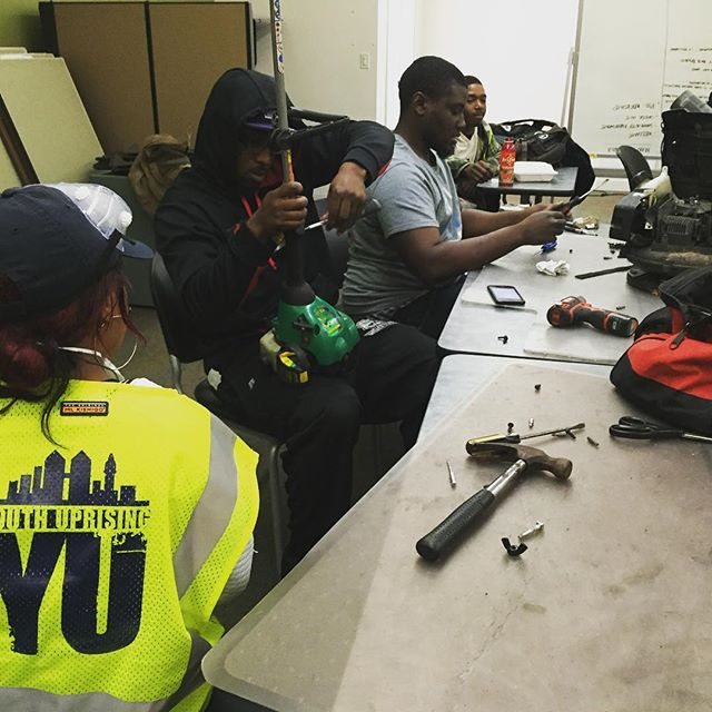 The YU Green team getting familiar with the inner workings of the tools they use.  #landscaping #maintenance #oakland #eastoakland #youthuprising #learn
