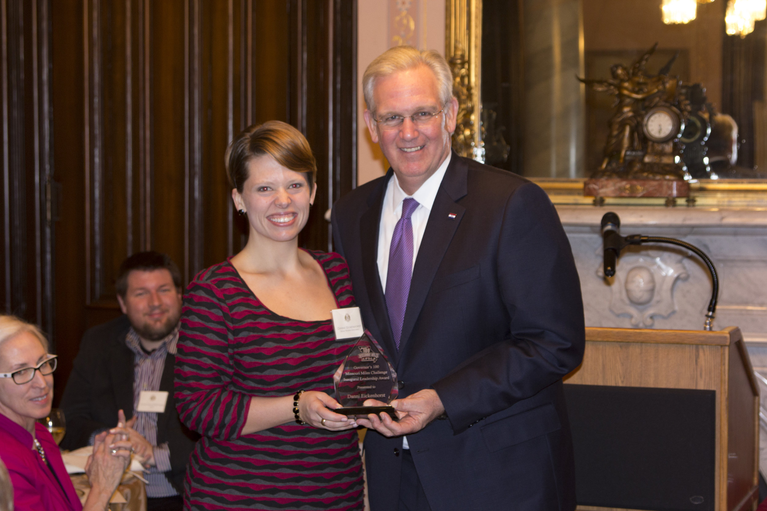 Receiving an award from Governor Jay Nixon for promotional strategy in his 100 Missouri Miles campaign.