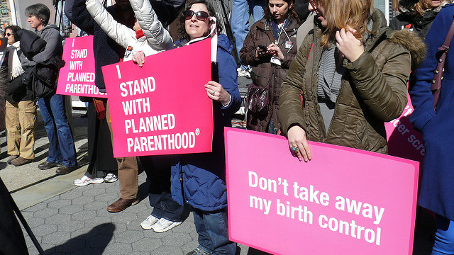 Placards from Planned Parenthood rally in New York City    by    Women's eNews    is licensed under    CC BY 2.0   .