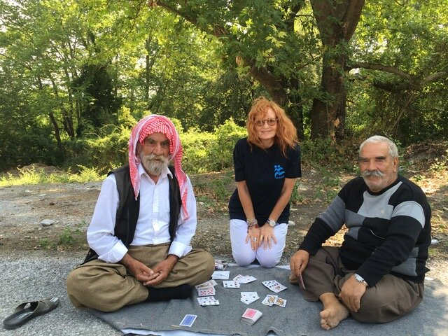 Playing cards with Yazidi elders.