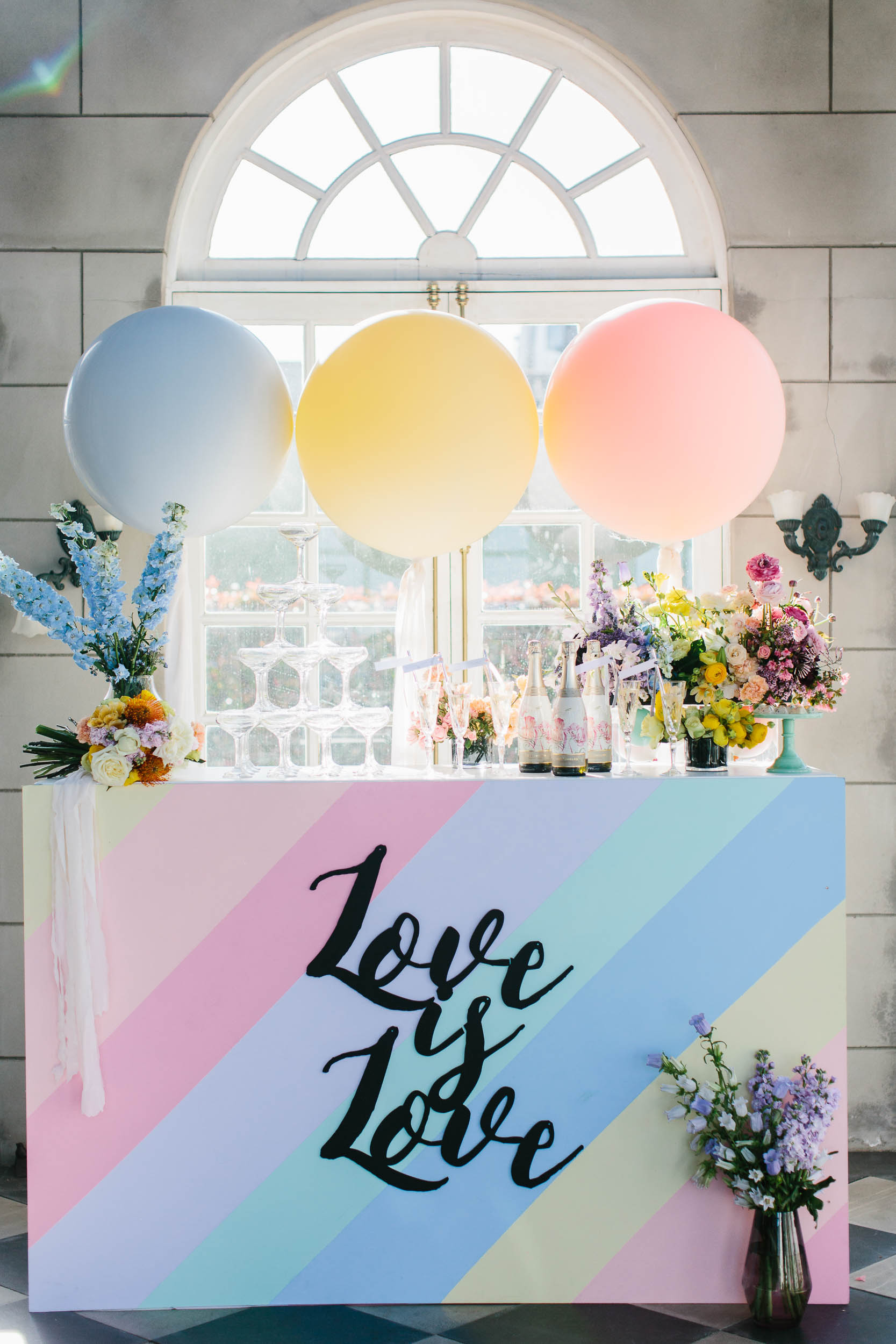 Colourful Bar with Champagne Tower | Wedding Photography by Kas Richards