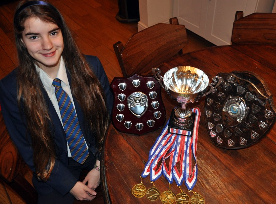 Piper with her medals and trophies