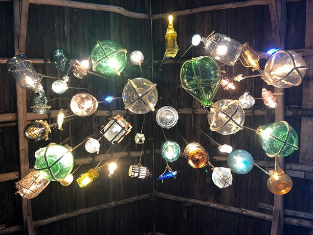 A close-up of our newly crafted antique wine bottle chandelier in the new Brewery Barn extension - unique and artistic touches abound at our farm!