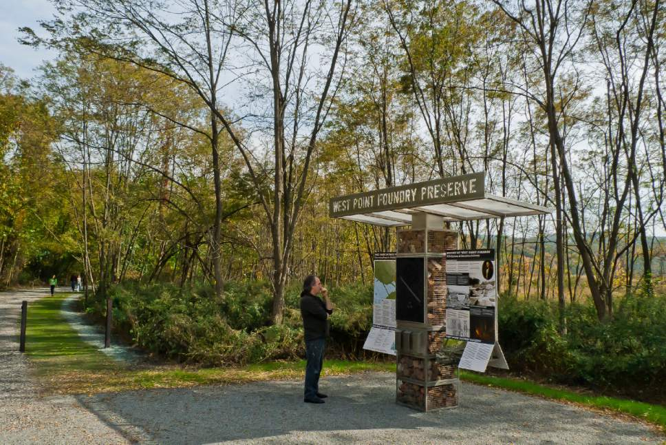This undated photo provided by C&G Partners and taken at the West Point Foundry Preserve in Cold Spring, N.Y. shows a freestanding trailhead which incorporates a cast-iron branding seal inspired by the original 1818 Foundry stationery logo, the site map and interpretive panels about early Cold Spring. The trailhead's mesh metal structure is filled with brick fragments taken directly from the Foundry ruins. The kiosk's canopy features laser-cut lettering identifying the Preserve. (C&G Partners via AP)