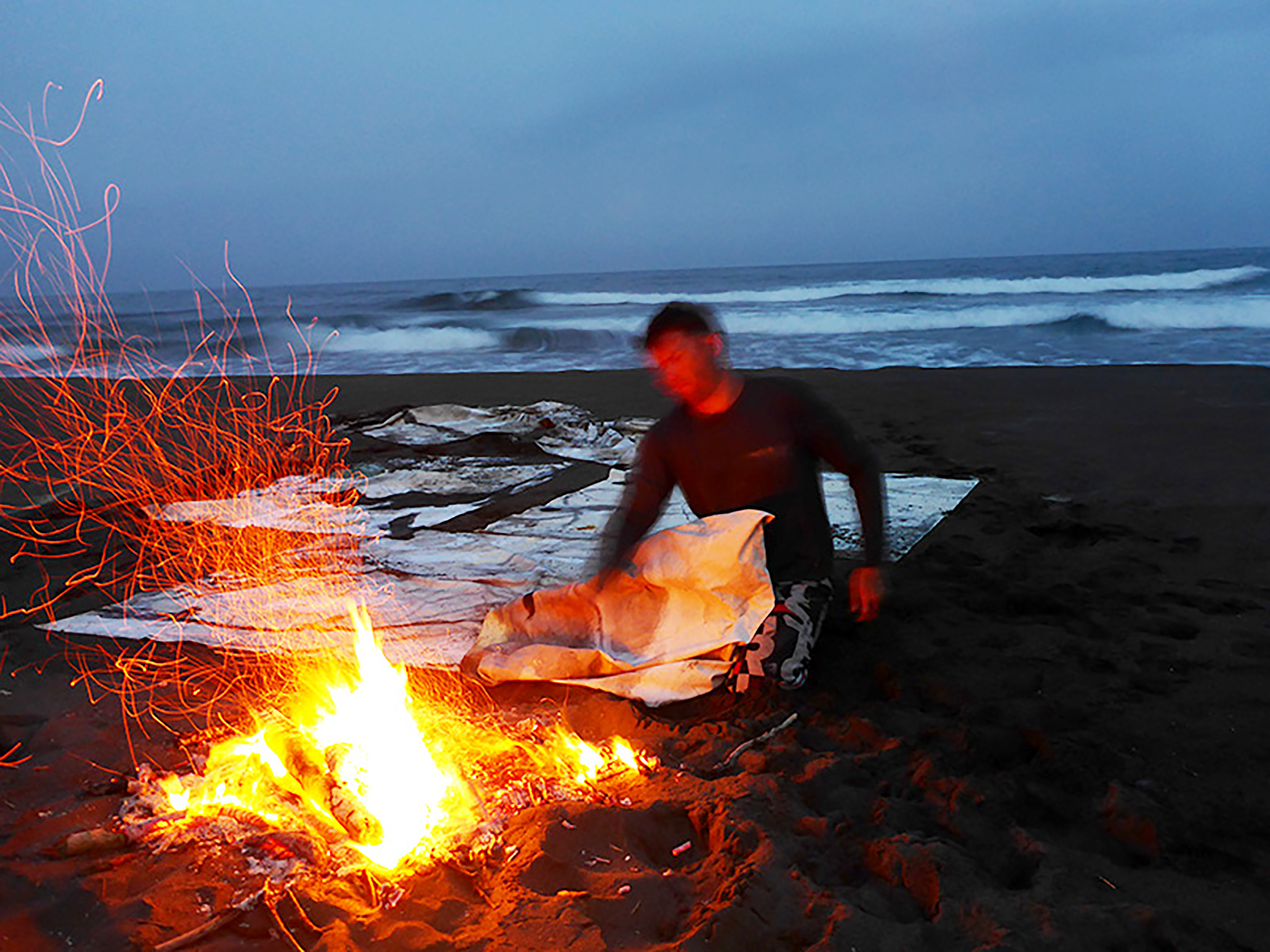 Drying the painting beside a driftwood fire on the Pacific coast of Taiwan, 2016