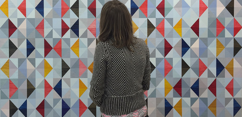 Emma Biggs in front of a painting by Biggs & Collings: All theborders, 2016