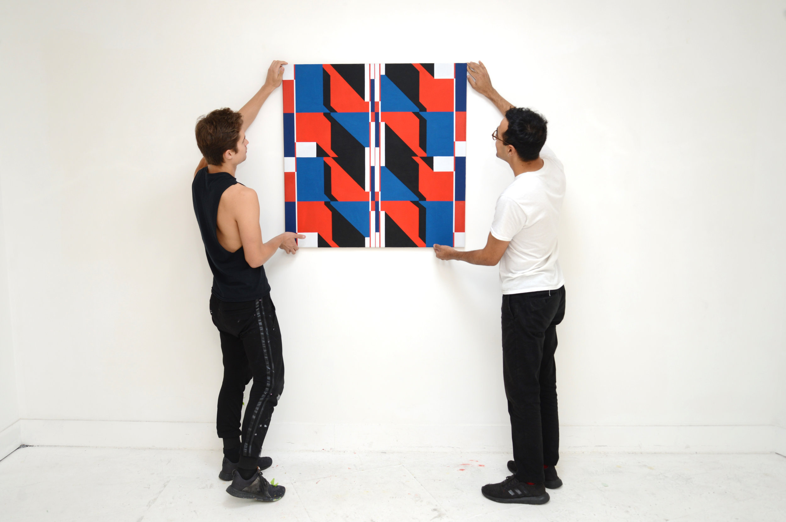 Kevin Umaña and Brandon Lipchik hanging the end of residency show in August 2018. (Artwork: Kevin Umaña)