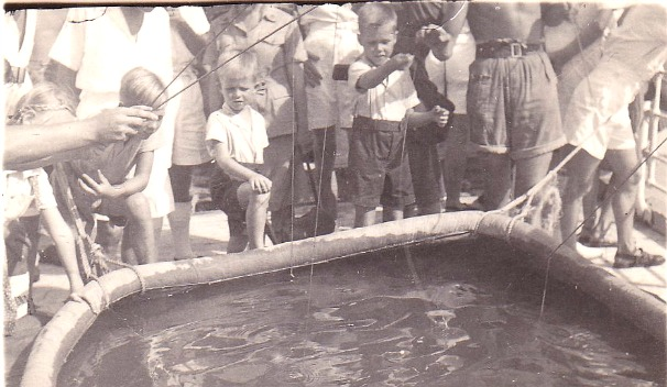 On the way back - HMS Bulolo crew entertain the Dutch children with a fishing game.