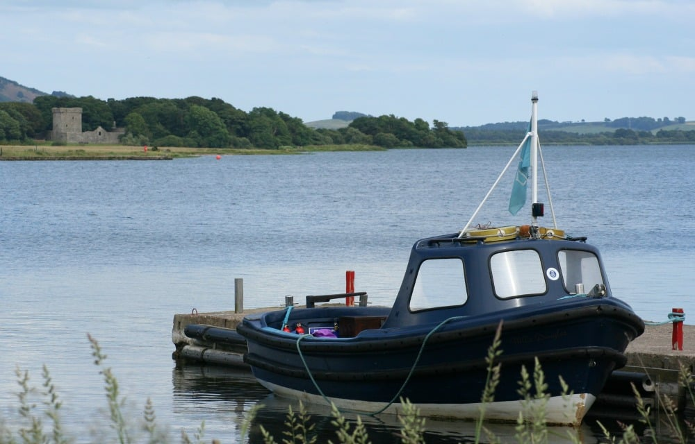 Visiting Loch Leven Castle, distant, left, means a short ferry ride to an island on the loch
