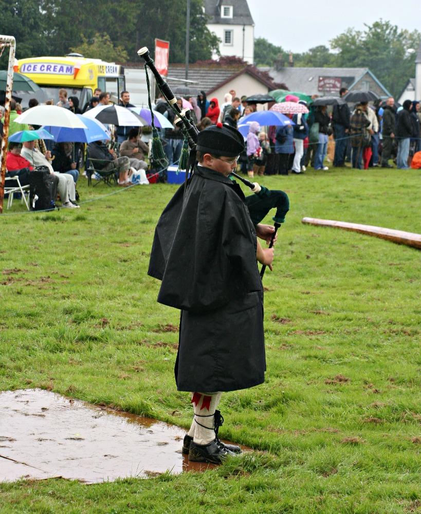 Piping in the rain at Killin Highland Games