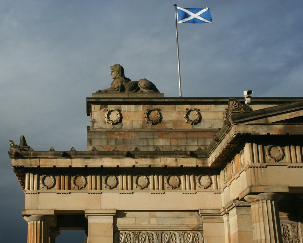 Scotland's flag, the Saltire, flying on the Royal Scottish Academy, in Edinburgh.