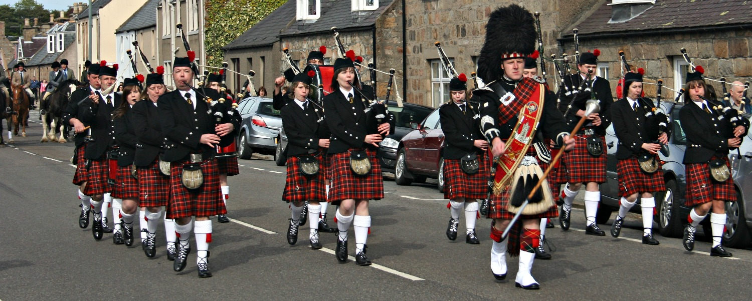 What is tartan? It's de rigeur for a pipe band. This one is in Aberlour, Moray