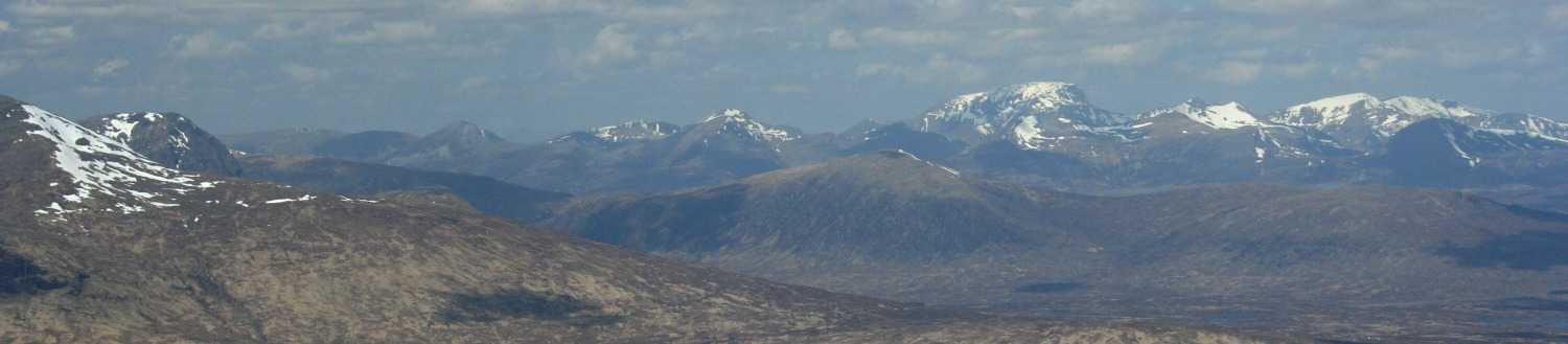 Guess which one is Ben Nevis? Yup, the tallest one, right of centre of horizon. Summit plateau showing prominently.
