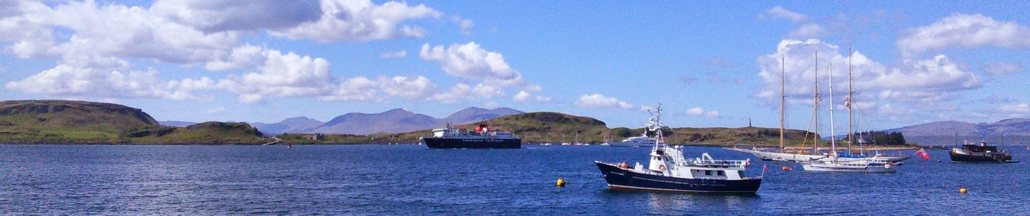 Inbound ferry (centre), and island of Mull peeping up beyond nearer little island of Kerrera - a typical Oban bay view.