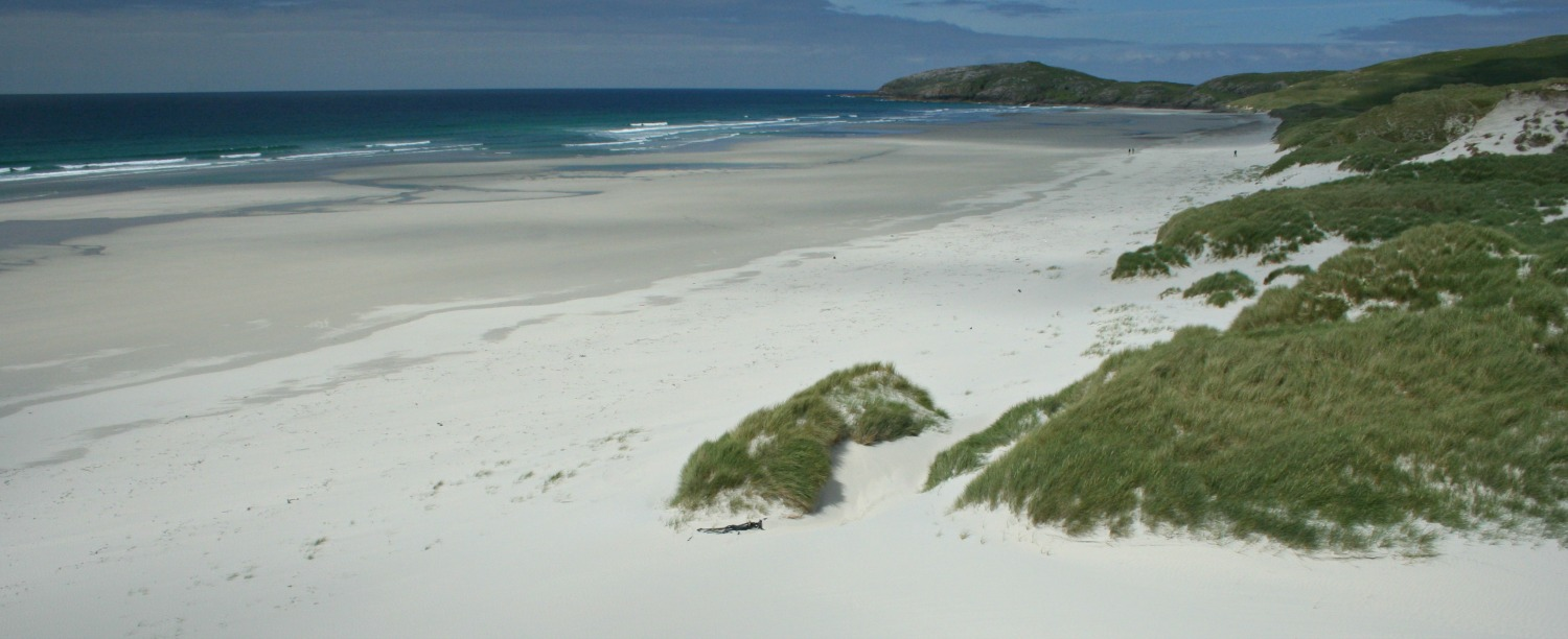 Walk over the dunes from Barra Airport terminal building to discover Traigh Eais.