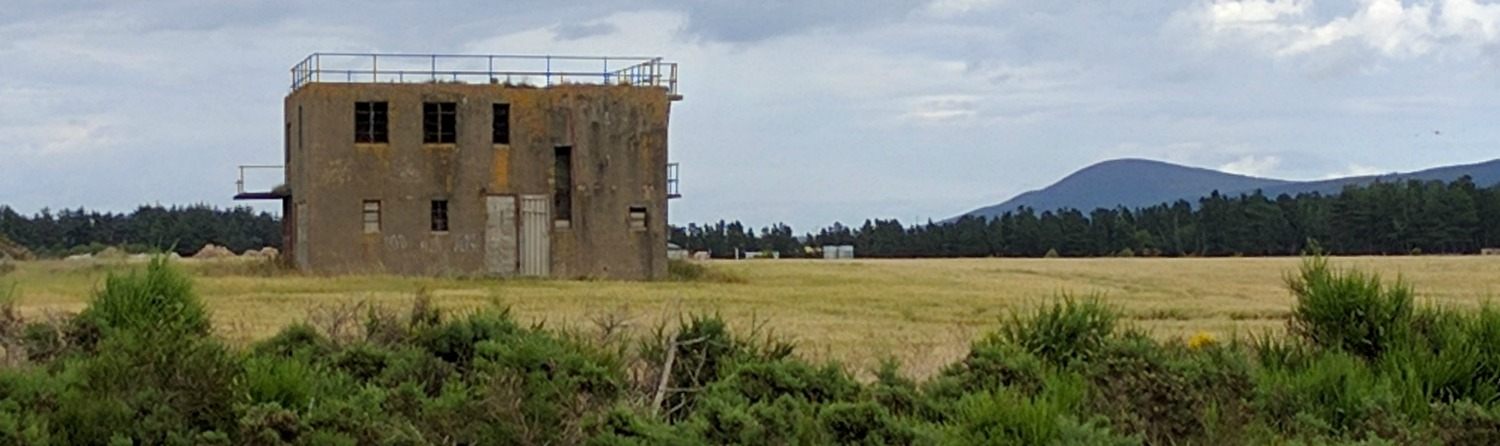 What is left of the RAF Dallachy control tower, lost in the barleyfields of rural Moray. Bin Hill of Cullen on the right.