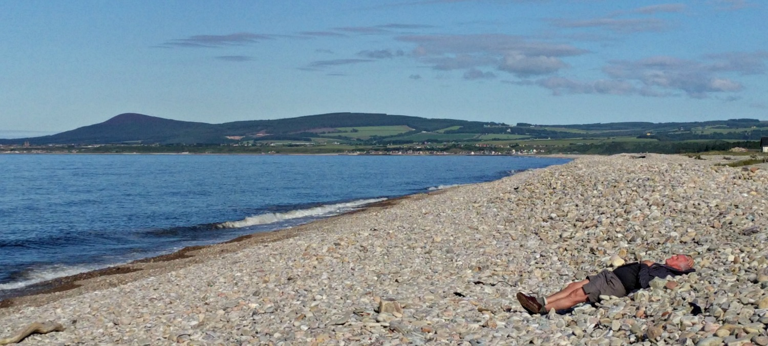 The countryside, especially the coast east of Inverness, by way of Moray and Aberdeenshire, can be quiet enough so that visitors are allocated a beach each on an individual basis. My friend here was lucky to get a last-minute cancellation, though he did find the big stones a bit uncomfortable.
