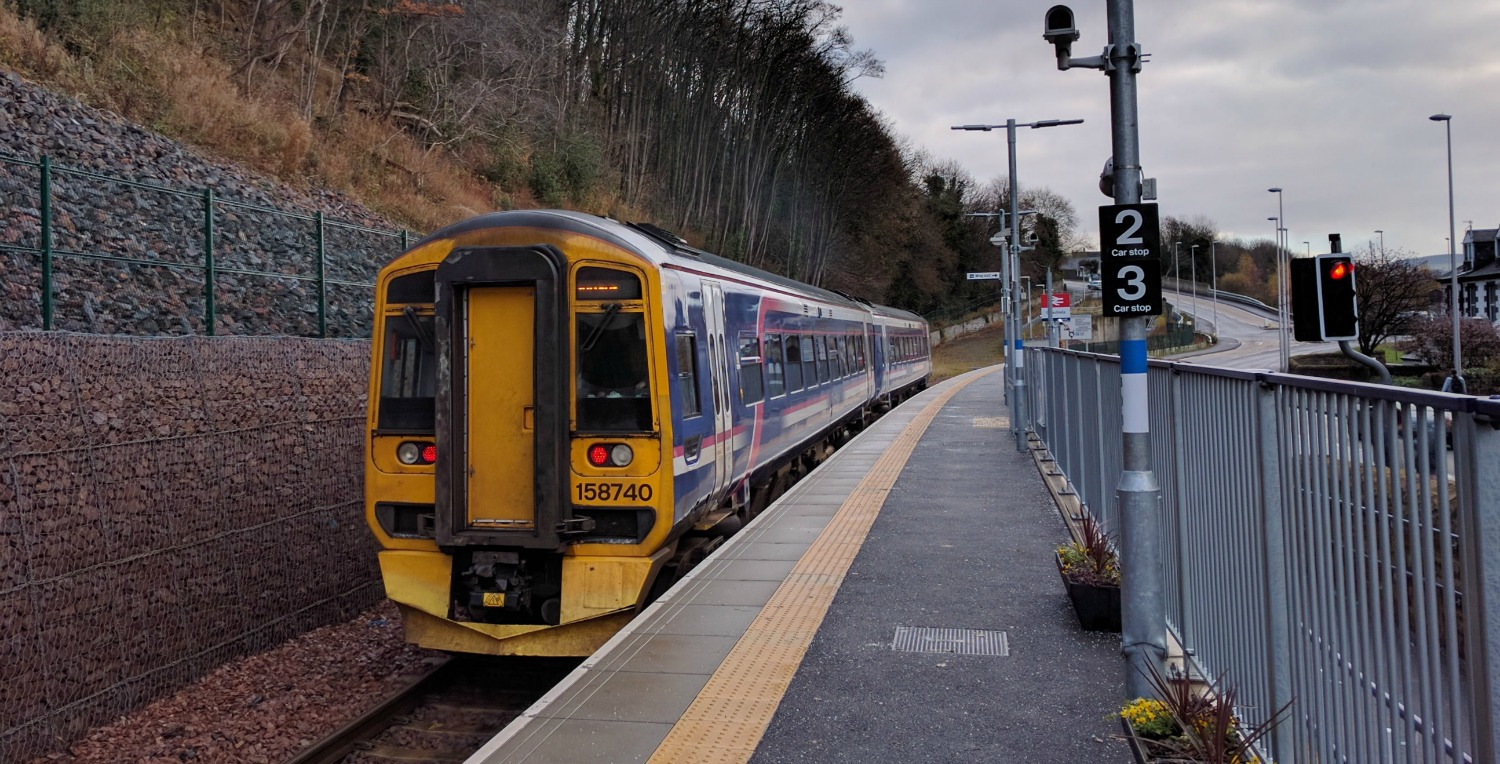 THE OLD CLASS 158 SPRINTER HEADS OUT OF GALA STATION FOR TWEEDBANK.